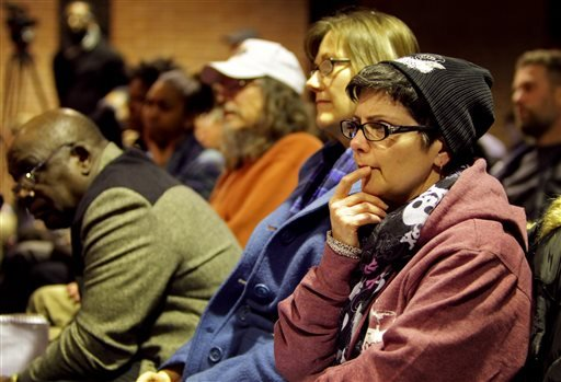 Stephanie VonDrasek, 54, listens to the public comments during the Ferguson city council meeting in Ferguson, Mo., on Tuesday, Feb. 9, 2016 where the consent decree with the United States Department of Justice was being talked about. The Ferguson city cou
