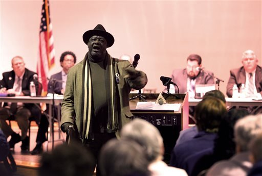 Louis Wilson, a Ferguson, Mo., resident for 16 years, turns to talk to the crowd Tuesday, Feb. 9, 2016, as he addresses the Ferguson city council during the public comment portion of a meeting where a consent decree with the United States Department of Ju