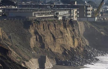 Living with the Pacific Ocean as your backyard has its benefits. But the crumbling ocean cliffs have forced dozens to move quickly and at a high cost. (AP Photo/Jeff Chiu, file)