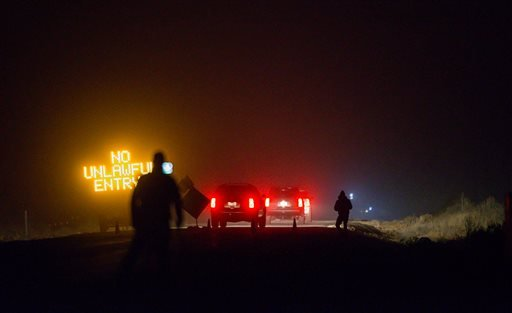 Three SUV proceeds through the Narrows roadblock near Burns, Ore., as FBI agents have surrounded the remaining four occupiers at the Malheur National Wildlife Refuge, on Wednesday, Feb.10, 2016. The four are the last remnants of an armed group that seized