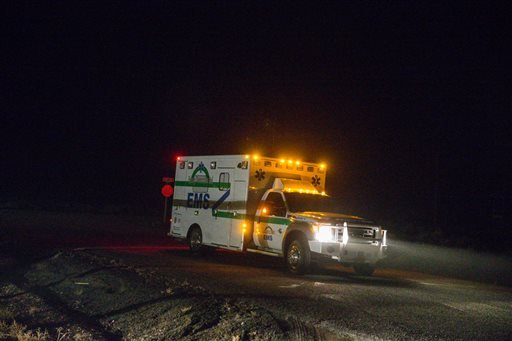An ambulance proceeds through the Narrows roadblock near Burns, Ore., as FBI agents have surrounded the remaining four occupiers at the Malheur National Wildlife Refuge, on Wednesday, Feb.10, 2016. The four are the last remnants of an armed group that sei