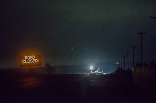 Lights are seen from the Narrows roadblock near Burns, Ore., as .FBI agents have surrounded the remaining four occupiers at the Malheur National Wildlife Refuge, on Wednesday, Feb.10, 2016. The four are the last remnants of an armed group that seized the