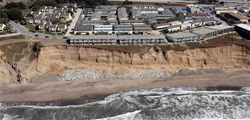 In this image provided by the California Coastal Records Project, cliff erosion is seen below the Esplanade Apartments in Pacifica, Calif., in 2009.