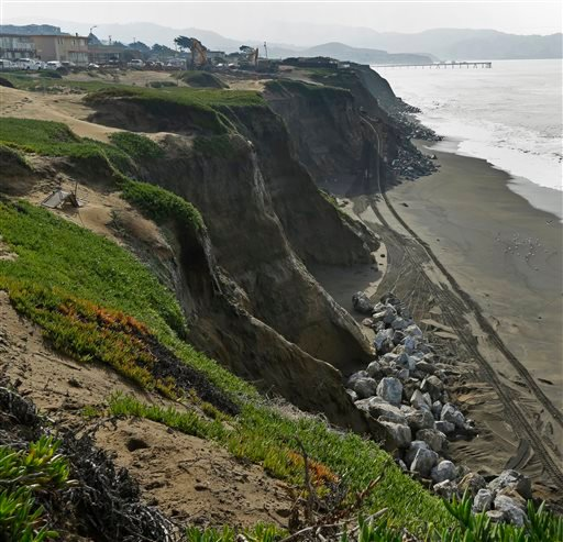 In this photo taken on Wednesday, Feb. 3, 2016, large boulders await placement at the base of eroding cliffs in Pacifica, Calif.