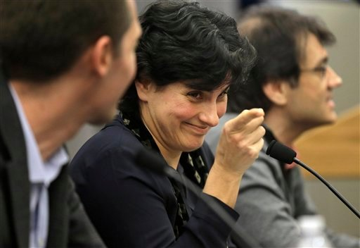 Massachusetts Institute of Technology astrophysics professor Nergis Mavalvala, center, addresses an audience of scientists and journalists as MIT physics professor Matthew Evans, left, and MIT research scientist Erik Katsavounidis, right, look on during a