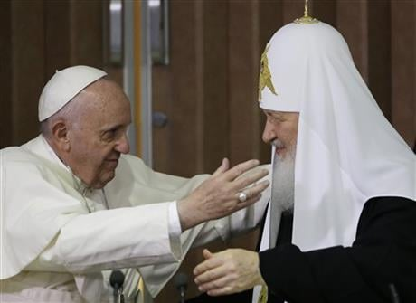 The two religious leaders met for the first-ever papal meeting, a historic development in the 1,000-year schism within Christianity. (AP Photo/Gregorio Borgia, Pool)
