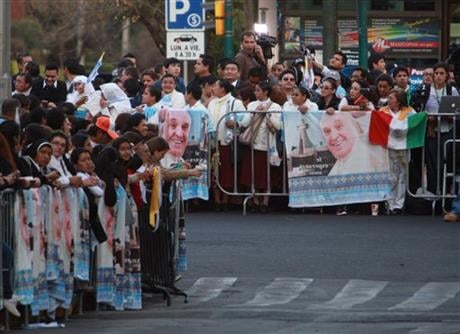 People wait along the route that Pope Francis will take from the airport to the Catholic Nunciatura in Mexico City, Friday, Feb. 12, 2016. Pope Francis is arriving Friday for a week-long visit. (AP Photo/Christian Palma)