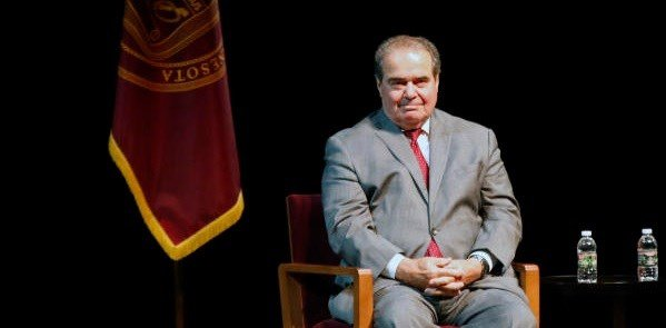 U.S. Supreme Court Justice Antonin Scalia waits during an introduction before speaking at the University of Minnesota as part of the law school's Stein Lecture series, Tuesday, Oct. 20, 2015, in Minneapolis.