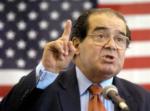 FILE - In this Wednesday, April 7, 2004 file photo, U.S. Supreme Court Justice Antonin Scalia speaks to Presbyterian Christian High School students in Hattiesburg, Miss. On Saturday, Feb. 13, 2016.