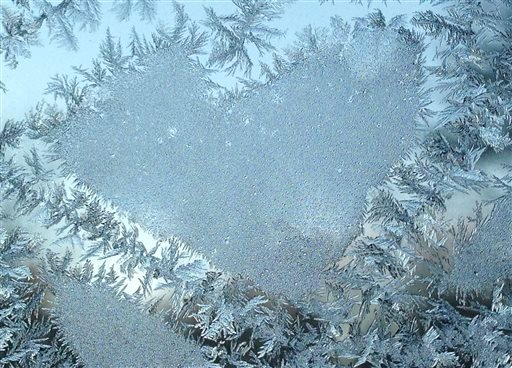 Frost on a window forms a heart-shaped pattern on Friday, Feb. 12, 2016, in Falmouth, Maine, where the early morning temperature dipped below zero.
