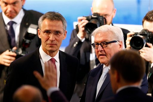 NATO Secretary General Jens Stoltenberg, left, and German Foreign Minister Frank-Walter Steinmeier arrive at the Security Conference in Munich, Germany, Saturday, Feb. 13, 2016. (AP Photo/Matthias Schrader)