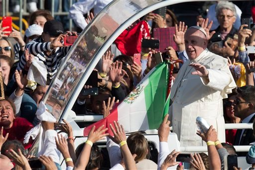 Catholic faithful cheer as Pope Francis drives by in his popemobile in Ecatepec, Mexico, Sunday, Feb. 14, 2016. Pope Francis will give a Mass at an outdoor field in the capital's suburb of Ecatepec to an estimated crowd of 400,000 pilgrims. It is to be hi