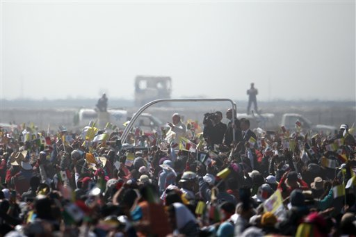 Pope Francis rides on a popemobile as he makes his way through pilgrims waiting for Mass in Ecatepec, Mexico, Sunday, Feb. 14, 2016. Pope Francis will give a Mass at an outdoor field in the capital's suburb of Ecatepec to an estimated crowd of 400,000 pil