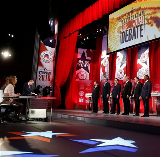 Republican presidential candidates, from left, Ohio Gov. John Kasich, former Florida Gov. Jeb Bush, Sen. Ted Cruz, R-Texas, businessman Donald Trump, Sen. Marco Rubio, R-Fla., retired neurosurgeon Ben Carson take a moment of silence for U.S. Supreme Court