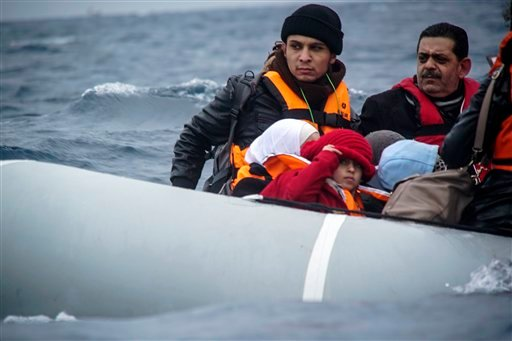 In this file photo dated Friday, Jan. 29, 2016, migrants cross the Aegean Sea aboard a dinghy as they arrive from the Turkish coast to the northeastern Greek island of Lesbos. Officials had expected the flow of desperate people fleeing war and poverty wo