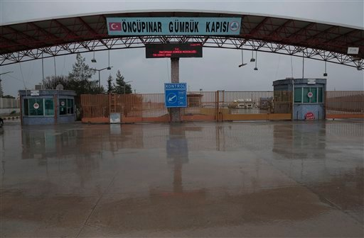 In this file photo dated Saturday, Feb. 6, 2016, the Turkish border crossing with Syria, is closed near to the town of Kilis, in southeastern Turkey, as some thousands of Syrian migrants are known to be moving toward the border, fleeing from fierce fighti