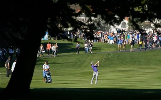 Jordan Spieth hits from the second fairway of the Pebble Beach Golf Links during the third round of the AT&T Pebble Beach National Pro-Am golf tournament Saturday, Feb. 13, 2016, in Pebble Beach, Calif. (AP Photo/Eric Risberg)