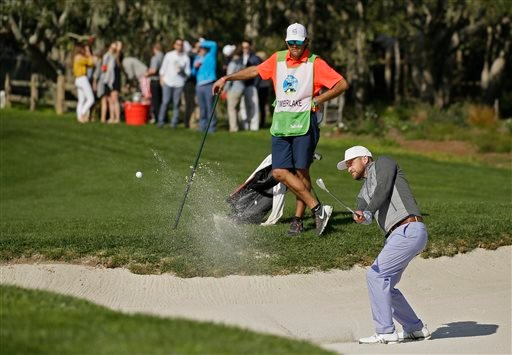 Justin Timberlake hits out of a bunker onto the second green of the Pebble Beach Golf Links during the third round of the AT&T Pebble Beach National Pro-Am golf tournament Saturday, Feb. 13, 2016, in Pebble Beach, Calif. (AP Photo/Eric Risberg)