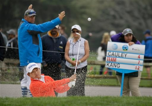 Sung Kang, of South Korea, follows his shot out of a bunker up to the second green of the Pebble Beach Golf Links during the third round of the AT&T Pebble Beach National Pro-Am golf tournament Saturday, Feb. 13, 2016, in Pebble Beach, Calif. (AP Photo/Er
