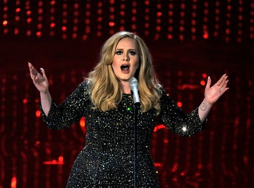 Feb. 24, 2013 file photo: singer Adele performs during the Oscars at the Dolby Theatre in Los Angeles. (Photo by Chris Pizzello/Invision/AP, File)