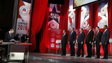 Republican presidential candidates take a moment of silence for U.S. Supreme Court associate justice Antonin Scalia, during the CBS News Republican presidential debate at the Peace Center Feb. 13, 2016, in Greenville, S.C. (AP Photo/John Bazemore)