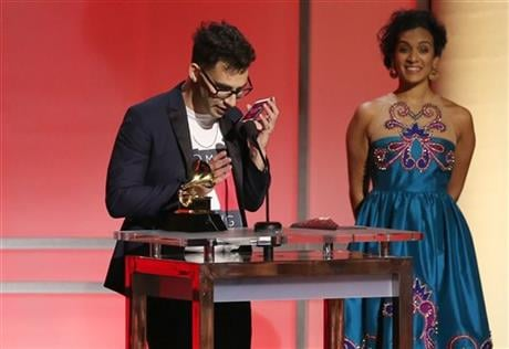 Jack Antonoff, left, calls Taylor Swift as he accepts their award for pop vocal album at the 58th annual Grammy Awards on Monday, Feb. 15, 2016, in Los Angeles. Looking on at right is Anoushka Shankar. (Photo by Matt Sayles/Invision/AP)