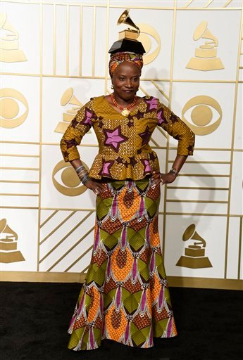 """Angelique Kidjo poses in the press room with the award for best world music album for """"Sings"""" at the 58th annual Grammy Awards at the Staples Center on Monday, Feb. 15, 2016, in Los Angeles. (Photo by Chris Pizzello/Invision/AP)"""