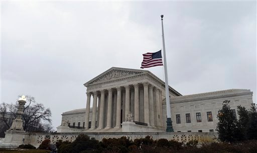 The flag flies at half-staff outside the Supreme Court in Washington, Tuesday, Feb. 16, 2016, following the death of Supreme Court Justice Antonin Scalia over the weekend.
