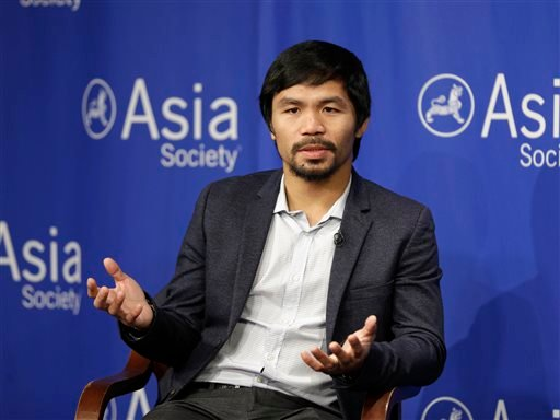 In this Oct. 12, 2015, file photo, Manny Pacquiao takes questions at the Asia Society in New York.