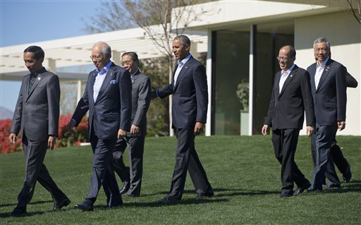 President Barack Obama, center, walks with leaders of ASEAN, the 10-nation Association of Southeast Asian Nations, for the official photo, Tuesday, Feb. 16, 2016 at the Annenberg Retreat at Sunnylands in Rancho Mirage, Calif. President Obama and leaders o