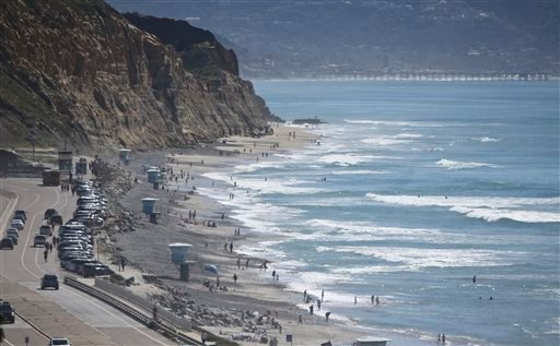 The tide moves in at Torrey Pines Beach in Del Mar, Calif., where beach goers enjoys unusually warm temperatures for February Tuesday, Feb. 16, 2016.