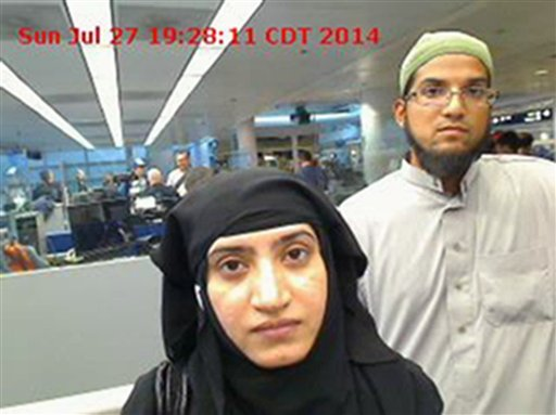 This July 27, 2014, photo provided by U.S. Customs and Border Protection shows Tashfeen Malik, left, and Syed Farook, as they passed through O'Hare International Airport in Chicago.
