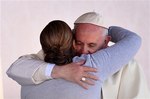 Pope Francis is embraced by a female inmate during his visit to the CeReSo n. 3 prison in Ciudad Juarez, Mexico, Wednesday, Feb. 17, 2016. Pope Francis is wrapping up his trip to Mexico with a visit to the prison just days after a riot in another lockup k