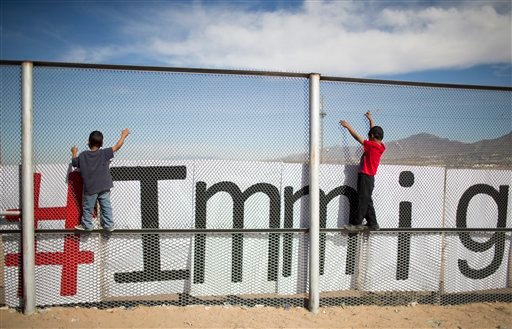 Two small boys balance themselves on the rail of a border fence during an event organized by the Border Network for Human Rights, on the outskirts of Ciudad Juarez, Mexico, Monday, Feb. 15, 2016. Pope Francis will conclude his weeklong Mexico trip with a