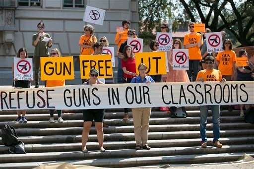 In this Oct. 1, 2015, file photo, protesters gather on the West Mall of the University of Texas campus to oppose a new state law that expands the rights of concealed handgun license holders to carry their weapons on public college campuses. University of