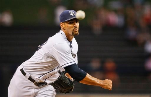 In this Aug. 31, 2015, file photo, San Diego Padres starting pitcher Tyson Ross works against the Texas Rangers in the first inning of a baseball game, in San Diego.