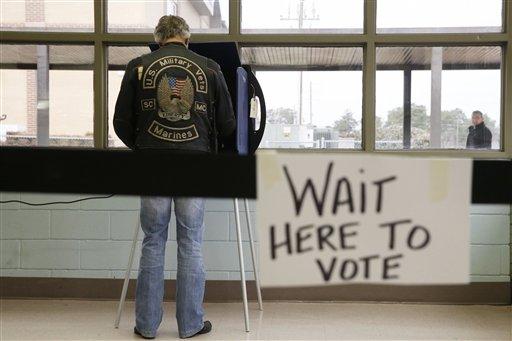 A South Carolina voter cast his ballot to vote in the Republican presidential primary Saturday, Feb. 20, 2016, in Lexington, S.C.