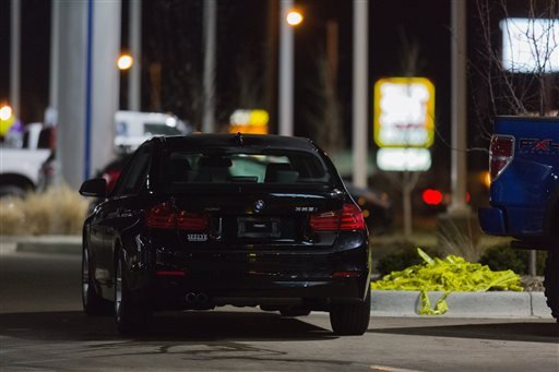 A vehicle sits at a car dealership after a random shooting on Sunday, Feb. 21, 2016 in Kalamazoo. Jason Dalton of Kalamazoo County was arrested early Sunday in downtown Kalamazoo following a massive manhunt after several victims were shot at random. (Brya