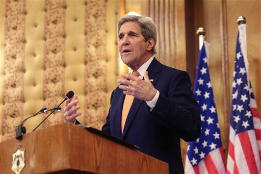 "Secretary of State John Kerry gestures during a joint press conference with his Jordanian counterpart Nasser Judeh (unseen) in Amman, Jordan, Sunday, Feb. 21, 2016. John Kerry said Sunday that a ""provisional agreement"" has been reached on a Syrian cease-f"