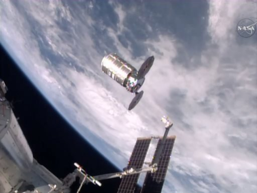 This photo taken from NASA TV shows a capsule loaded with 1.5 tons of trash, released from the International Space Station on Friday, Feb. 19, 2016. NASA supplier Orbital ATK launched the capsule, named Cygnus, to the space station in December, full of fo