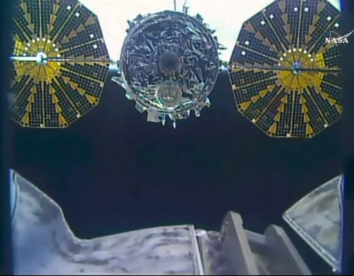 This photo taken from NASA TV shows a close up of a capsule loaded with 1.5 tons of trash released from the International Space Station on Friday, Feb. 19, 2016. NASA supplier Orbital ATK launched the capsule, named Cygnus, to the space station in Decembe