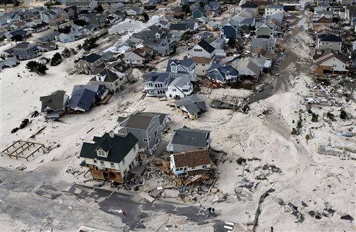 In this Oct. 31, 2012 file photo, a view from the air shows the destroyed homes left in the wake of Superstorm Sandy in Ortley Beach, N.J. Sea levels on Earth are rising several times faster than they have in the past 2,800 years and are accelerating beca