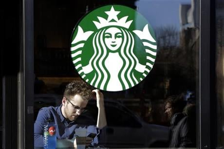 Starbucks is changing the terms of its rewards program so that people who just get a regular cup of coffee will have to spend significantly more to earn a freebie. AP