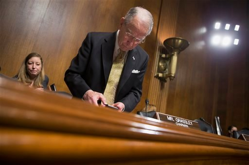 Senate Judiciary Committee Chairman Sen. Chuck Grassley, R-Iowa, arrives for a committee hearing on Capitol Hill in Washington, Tuesday, Feb. 23, 2016. Senate Republicans, most vocally Majority Leader Mitch McConnell, are facing a high-stakes political sh