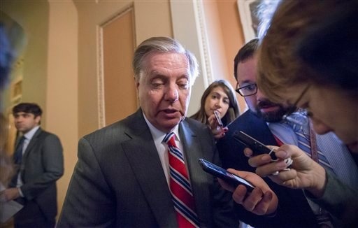 Sen. Lindsey Graham, R-S.C., a member of the Senate Judiciary Committee, speaks with reporters as he leaves a closed meeting in the office of Senate Majority Leader Mitch McConnell of Ky., on Capitol Hill in Washington, Tuesday, Feb. 23, 2016. Senate Repu