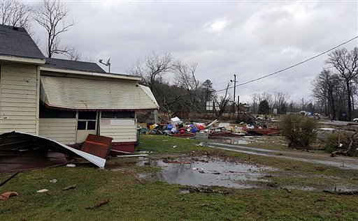 Debris is strewn on a lawn after a possible tornado moved through Waverly, Va. on Wednesday, Feb. 24, 2016. two people killed in eastern Virginia were in the town of Waverly, said Ron Messina, a spokesman for the state Department of Game and Inland Fisher