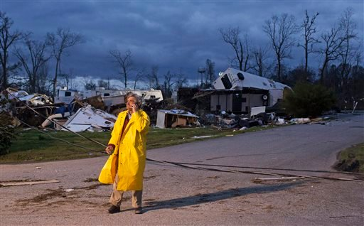 Director of Emergency Operations for St. James Parish Blaise Gravois talks on the phone at Sugar Hill RV Park following a storm in Convent, La., Wednesday, Feb. 24, 2016. Tornadoes and severe weather ripped through the Gulf Coast on Tuesday, mangling trai