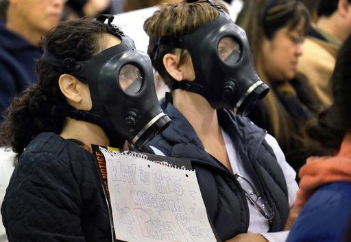 In this Jan. 16, 2016, file photo, protestors wearing gas masks, attend a hearing over a gas leak at the southern California Gas Company's Aliso Canyon Storage Facility near the Porter Ranch section of Los Angeles. Scientists say a gas leak that forced th