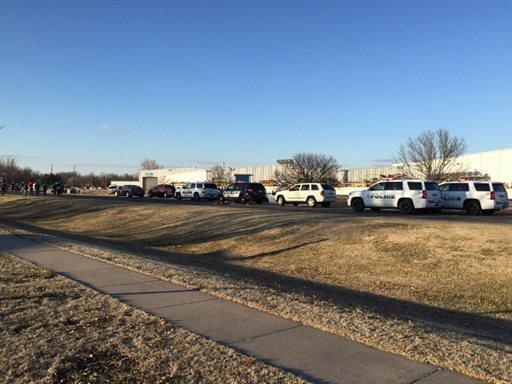 In this photo provided by KWCH-TV, police vehicles line the road after reports of a shooting in Hesston, Kan., Thursday, Feb. 25, 2016. A Harvey County sheriff's dispatcher said the shooting occurred Thursday afternoon at Excel Industries. (KWCH-TV via AP
