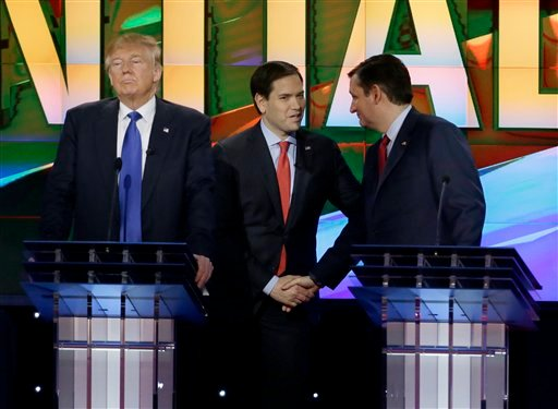 Republican presidential candidate, businessman Donald Trump, pauses as Republican presidential candidate, Sen. Marco Rubio, R-Fla., center and Republican presidential candidate, Sen. Ted Cruz, R-Texas, greet at a break during the debate.